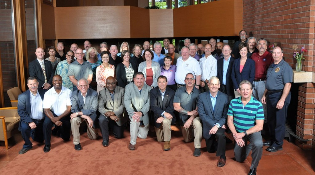 Group photo of Wingspread participants - Chief Wilson on front row, 4th from the left.