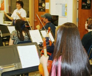 Centre Strings will hold its first rehearsal of the year on Tuesday, September 13,6:30 p.m. to 7:45 p.m., Lyn Schenbeck, above, in background, directs the community orchestra, and invites local concert strings musicians to join for the group's 10th anniversary season.