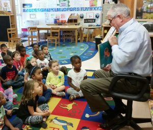 Coweta County Sheriff Mike Yeager reads to Pre-Kindergarten students in teacher Pam Sandlin's pre-k class.