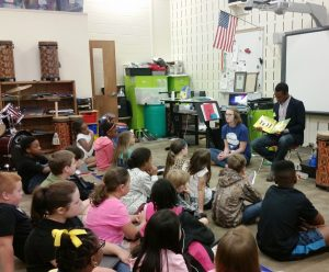 """Newnan High School students Maddie Ellsworth and Trey Herring read """"The Bear Ate Your Sandwich"""" at Atkinson Elementary School, as a part of Thursday's Read for the Record event."""