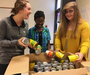 East Coweta High School Student Government members organize their school's Can-A-Thon drive.  The high school raised the most food and cash donation – the equivalent of 17,000 items – of all Coweta schools.