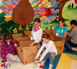 Coweta County elementary, middle and high schools participated in this year's Newnan Junior Service League can-A-Thon, raising approximately 150,000 items to support the annual drive.  Above, students at Welch Elementary school sort donated food items into boxes.