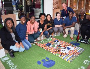 """Newnan High School Students held a 'Canstruction"""" event to promote their school's food drive."""